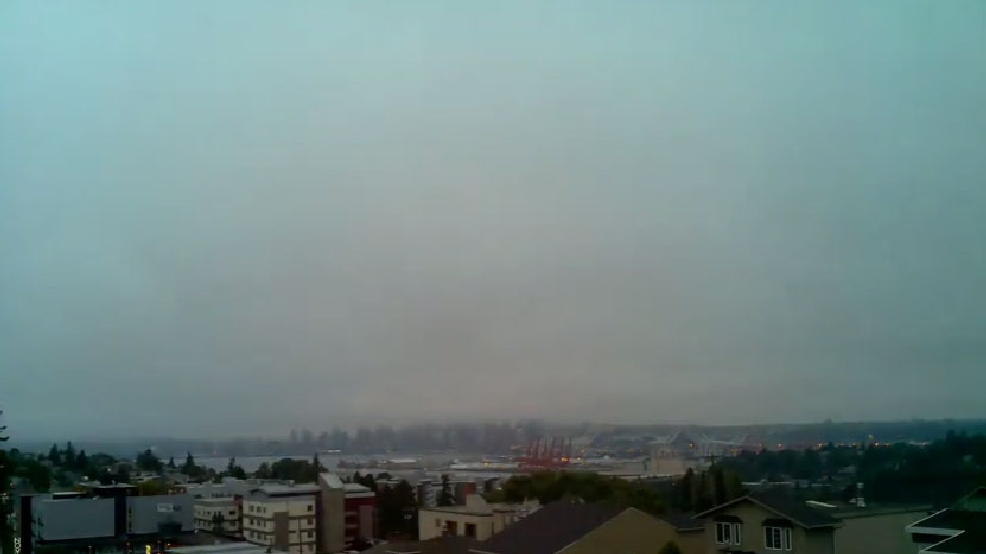 Watch: Marine layer rolls into Seattle