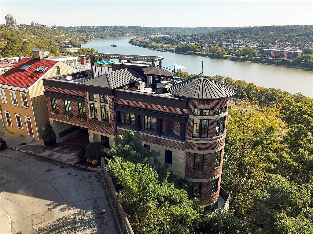 <p>1112 Carney Street in Mt. Adams - $2,695,000 / Another LEED Platinum-certified house, but this one is on the precipice of one of Mt. Adams' steep sides, offering amazing views of the river below. Of course, it has a rooftop terrace that's big enough to host a party (Labor Day fireworks are probably incredible from that spot), and this one also comes with a three-car garage as well as two off-street spaces for guests. Essentially, it's the ultimate Mt. Adams mansion if you want to share your space with your family and friends. / Our favorite feature: The beautiful kitchen inside the turret! / Image: Sibcy Cline // Published: 1.9.20</p>