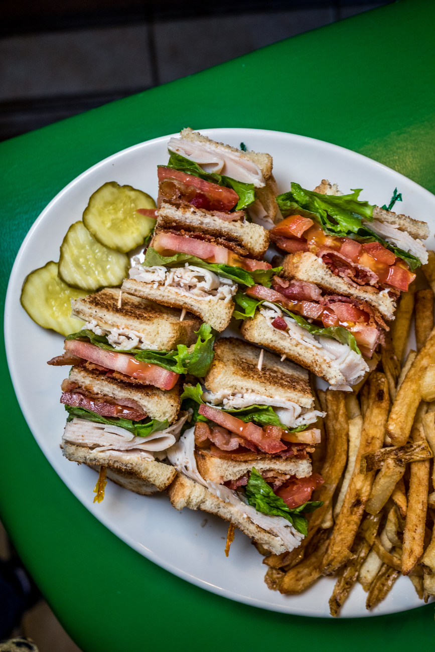 Club Double Decker: oven roasted turkey with two pieces of bacon, lettuce, and tomato on three pieces of toasted white or wheat bread and served with a side of french fries and pickles / Image: Catherine Viox // Published: 2.2.20