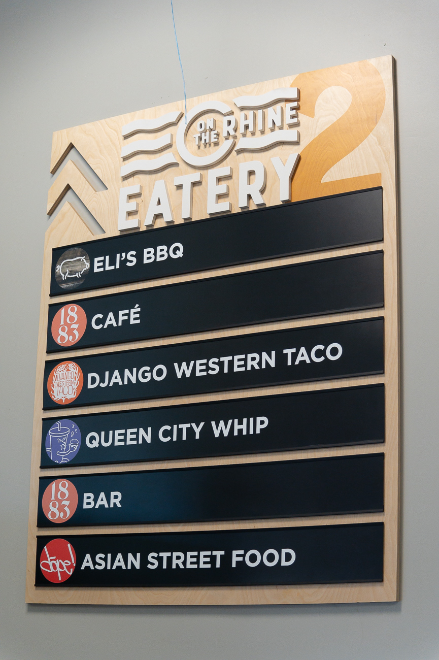 On the second level customers will find multiple local restaurants and a bar: Django Western Taco, Eli's BBQ, Queen City Whip, Dope Asian Street Food, and 1883 Cafe and Bar. / Image: Phil Armstrong, Cincinnati Refined // Published: 9.24.19