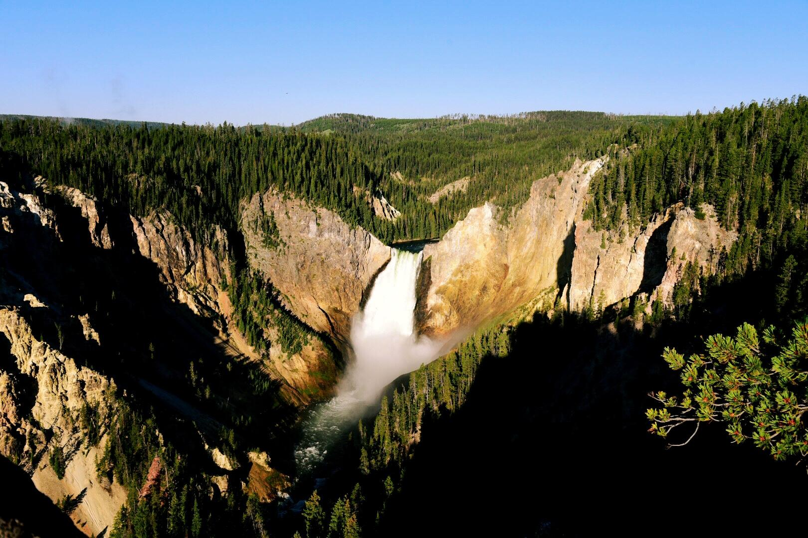 Yellowstone Falls consists of three falls with the Lower Falls being the most popular and the ones that Thomas Moran painted in his famous painting. (Image: Rebecca Mongrain/Seattle Refined)