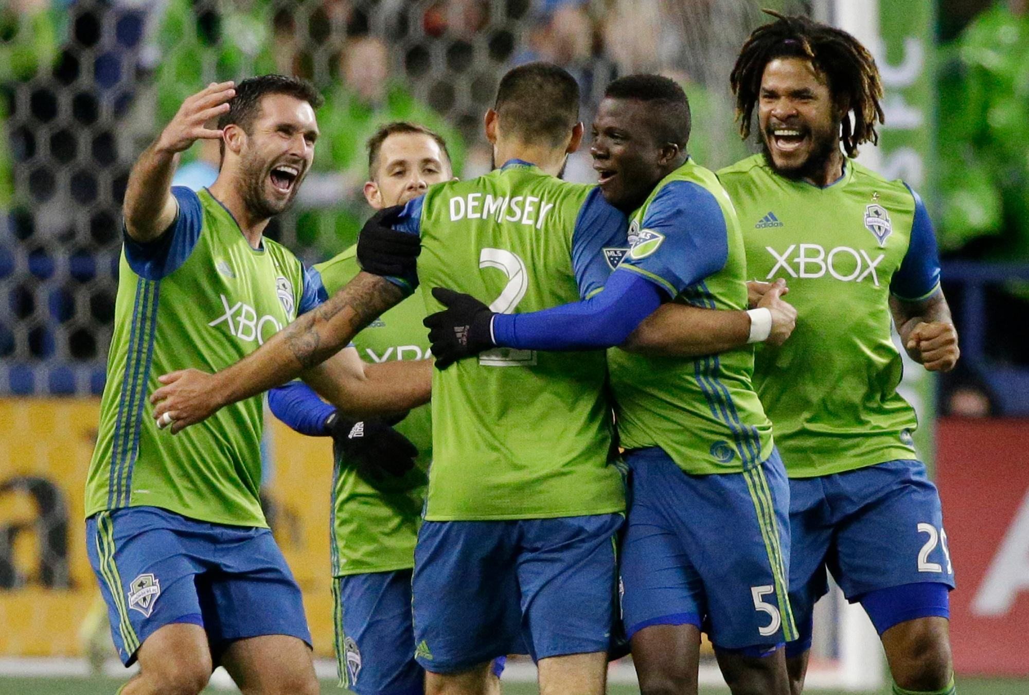 FILE - In this Nov. 3, 2017, file photo, Seattle Sounders forward Clint Dempsey (2) is greeted by teammates after he scored the first of two goals in the second half of the second leg of an MLS soccer Western Conference semifinal against the Vancouver Whitecaps in Seattle. Dempsey has been named the MLS Comeback Player of the Year after a heart condition in 2016 put his career in jeopardy. Dempsey was the choice after scoring 12 goals in the 2017 regular season and leading Seattle to a second-place finish in the MLS Western Conference. The Sounders will face Houston in the Western Conference finals beginning Nov. 21, 2017. (AP Photo/Ted S. Warren, file)