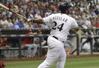 Milwaukee Brewers' Jesus Aguilar hits a two-run home run during the eighth inning of a game against the St. Louis Cardinals Wednesday, Aug. 2, 2017, in Milwaukee.