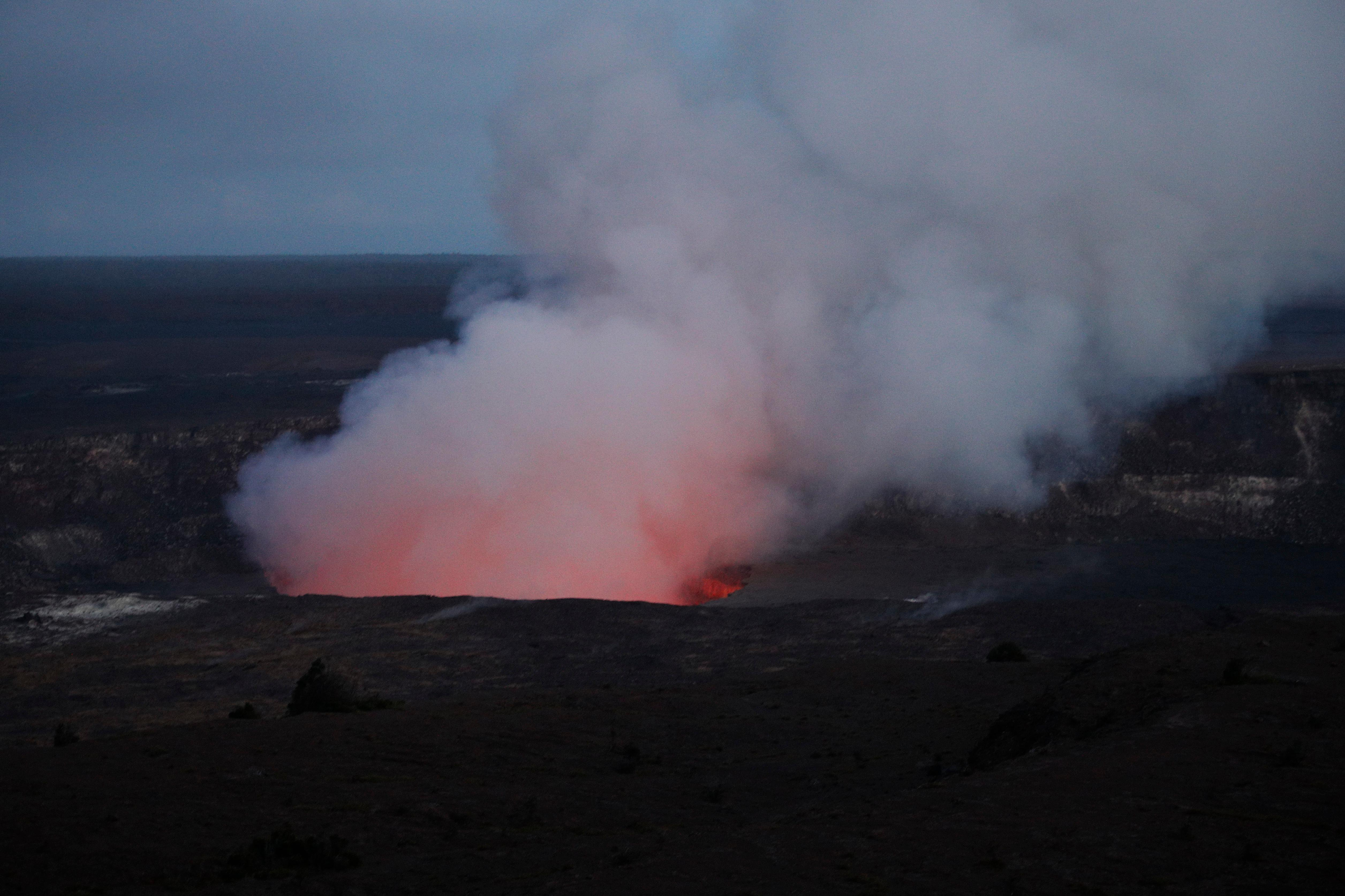Steam and gas rise from Kilauea's summit crater in Volcanoes National Park, Hawaii, Wednesday, May 9, 2018. Geologists warned Wednesday that Hawaii's Kilauea volcano could erupt explosively and send boulders, rocks and ash into the air around its summit in the coming weeks. (AP Photo/Jae C. Hong)