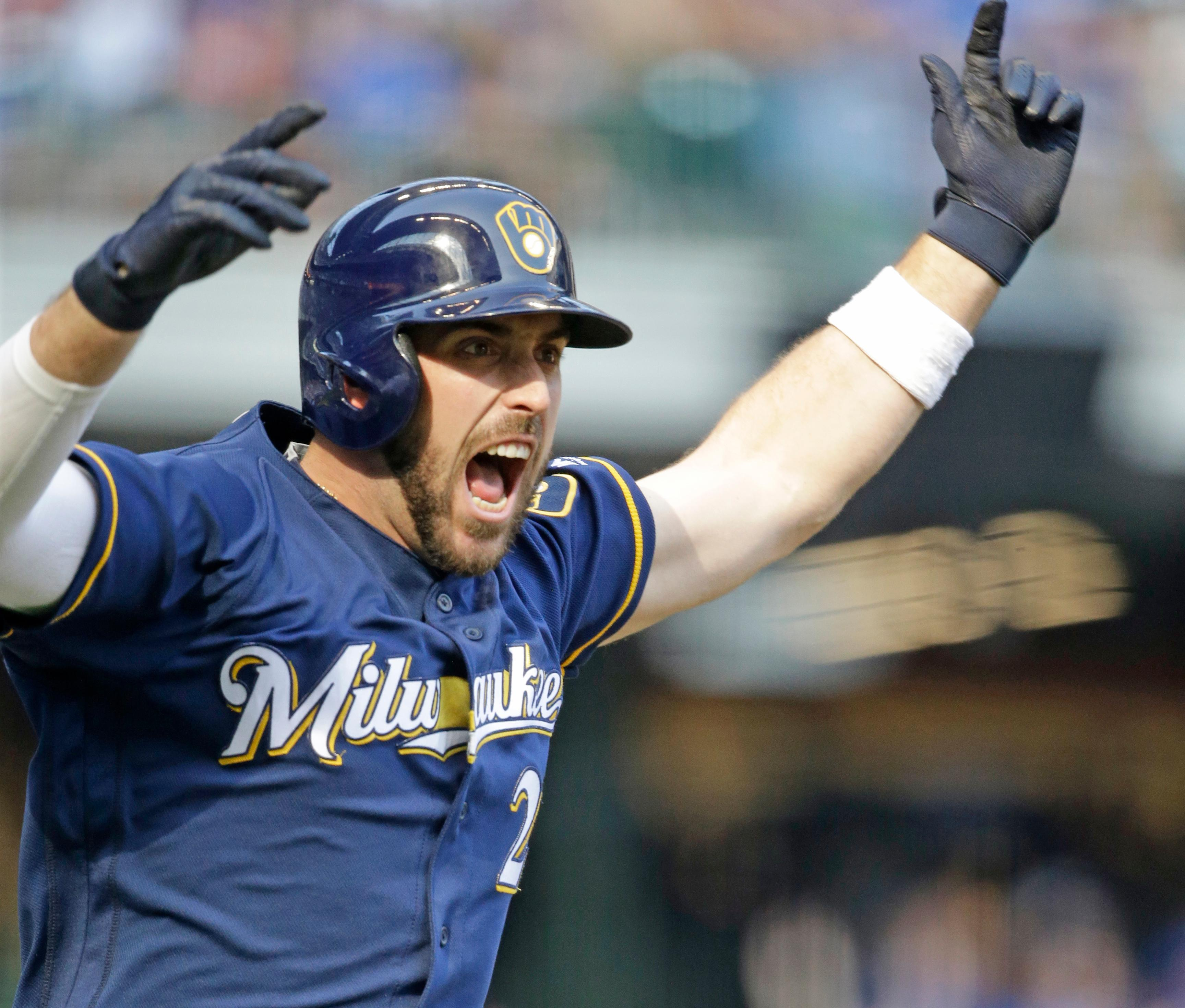Milwaukee Brewers' Travis Shaw reacts after his two-run game winning home run against the Chicago Cubs during the 10th inning Saturday, Sept. 23, 2017, in Milwaukee. The Brewers won 4-3 in 10 innings. (AP Photo/Jeffrey Phelps)