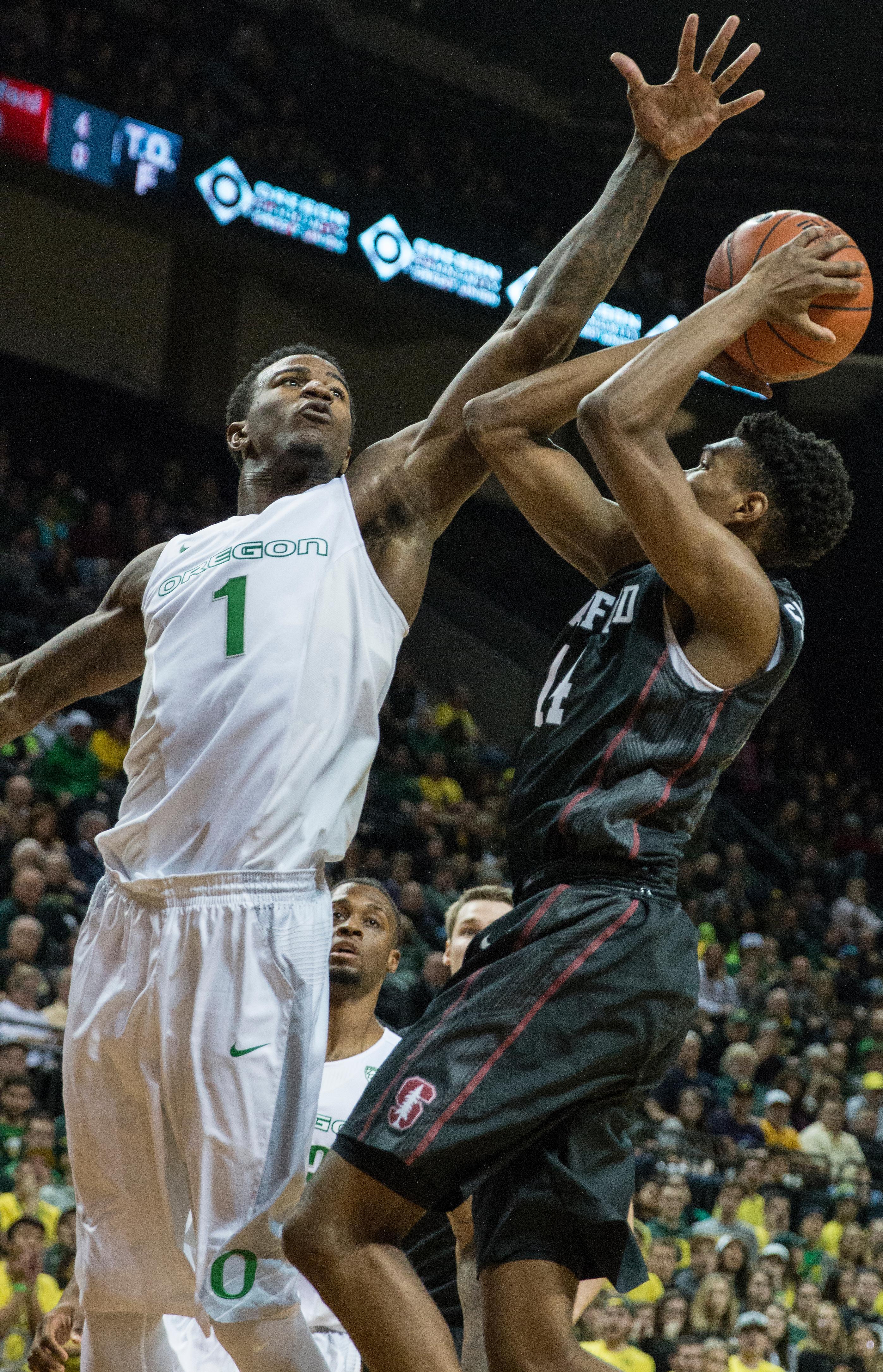 Oregons Forward Jordan Bell 1 Defends The Shot Of Stanford Guard Marcus Sheffield