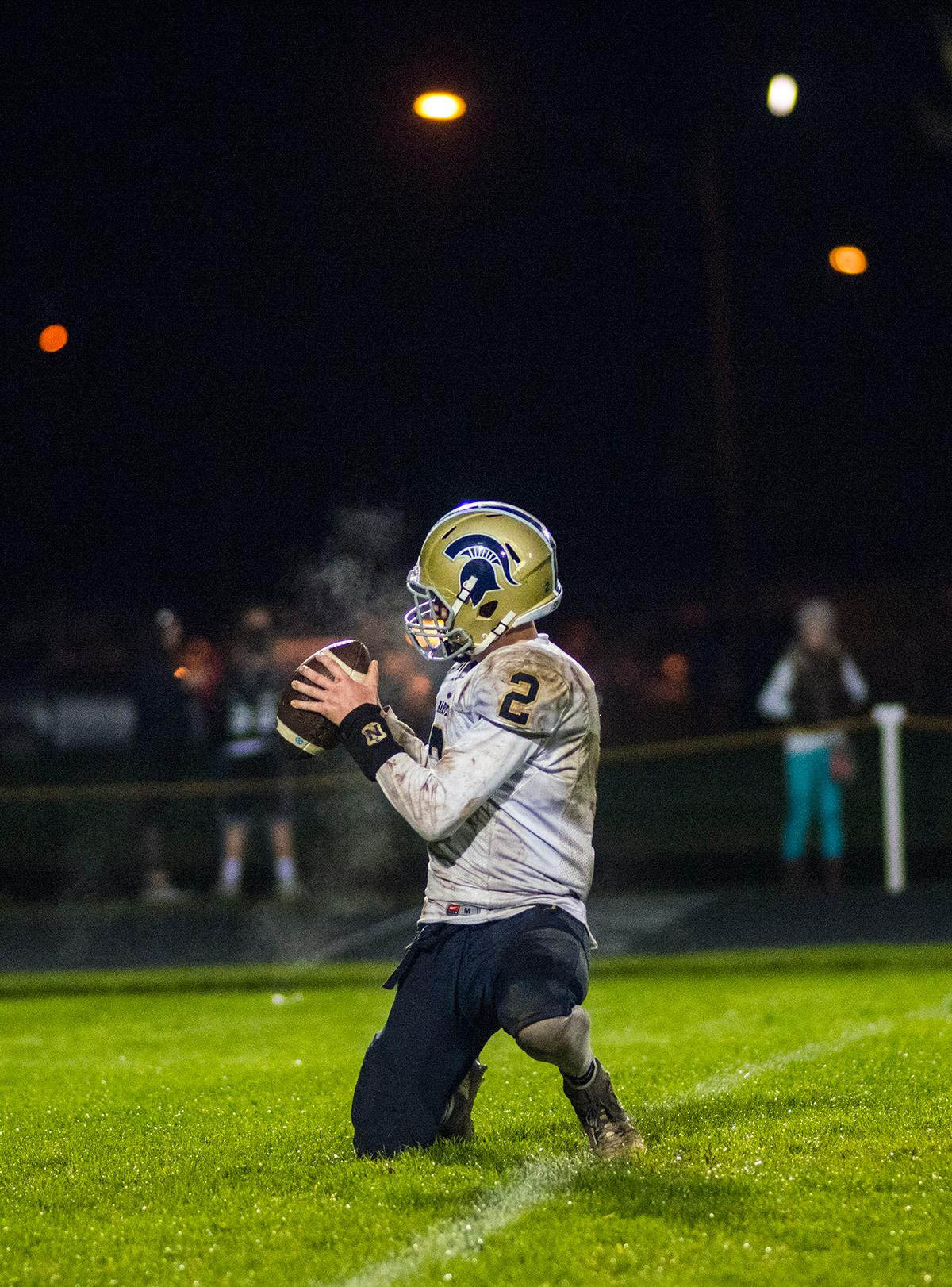 Marist Spartans Max Whittaker (#2) catches the ball before he places it on the yard line for the kicker. Thurston Colts defeated Marist Catholic Spartans 50-14 to seal second place in their conference on Friday night at Thurston High School. Photo by Rhianna Gelhart, Oregon News Lab