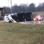 Tractor-trailer overturns on sharp curve at Hurdland