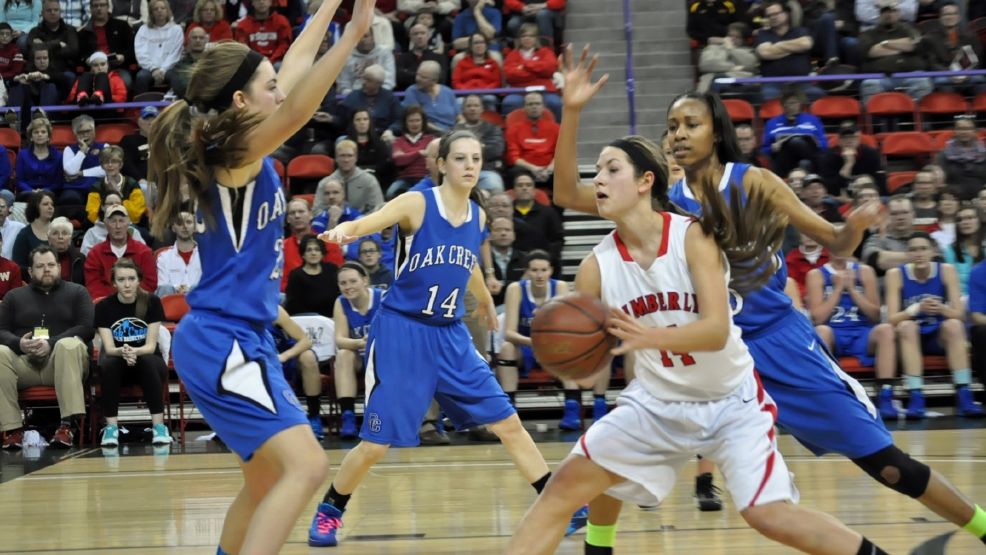 Kimberly's Jenna Smarzinski look to pass against Oak Creek druing their Division 1 state semifinal game at the Resch Center on Friday. (Doug Ritchay/WLUK)