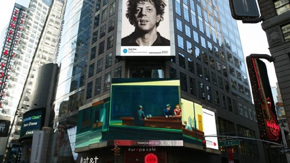 "This artist's rendering provided by Art Everywhere U shows, a display in New York's Times Square features Chuck Close's ""Phil,"" top, and Edward Hopper's ""Nighthawks."" Famous artwork is about to hit America's streets and public places. Images of American artworks will appear on billboards, bus stops, digital display boards and subway platforms August 4 through August 31. The Close painting is in the collection of the Whitney Museum of Art in New York and the Hopper work is in the Friends of American Art Collection at the Art Institute of Chicago. (AP Photo/Art Everywhere US)"
