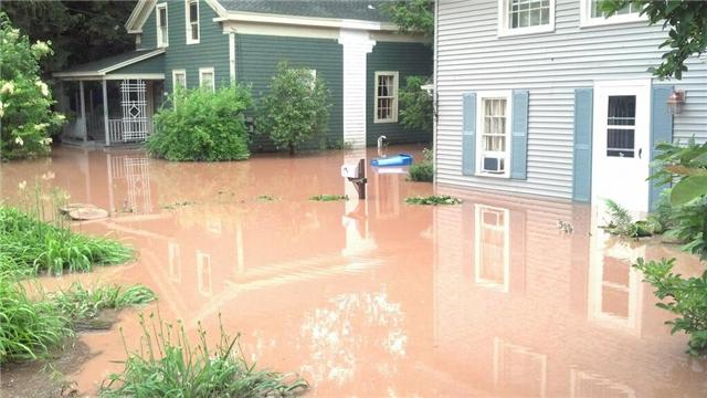 Flooded homes along College Drive near Hamilton College in Clinton