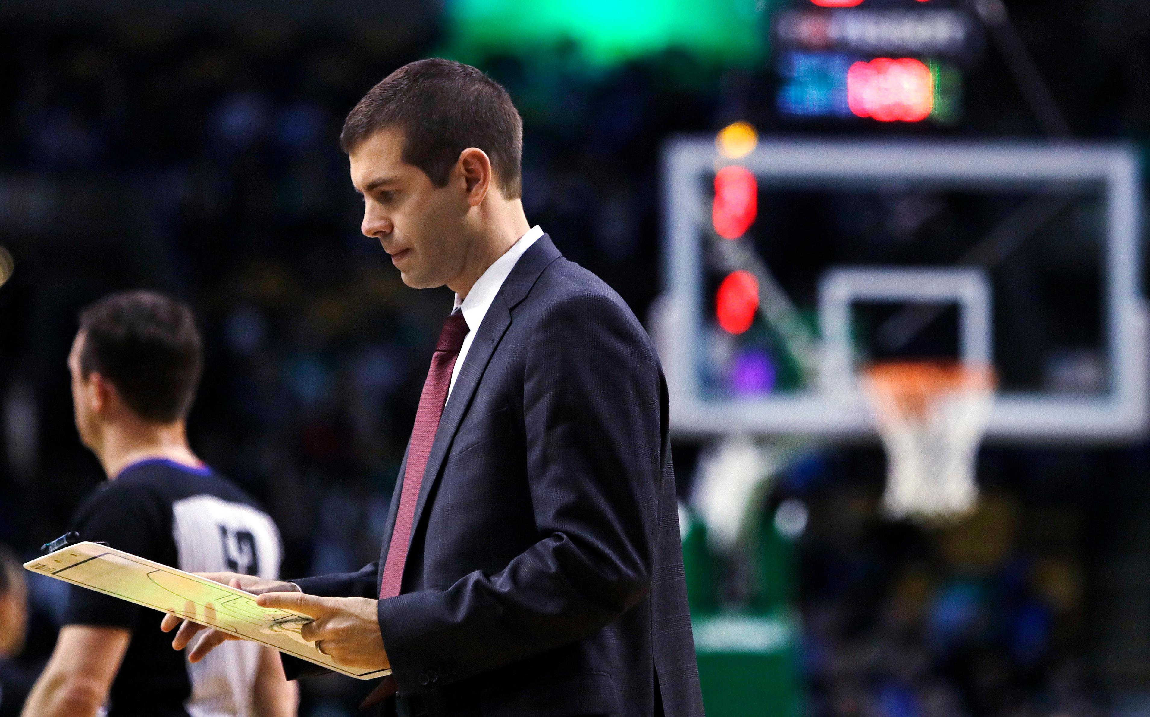 Boston Celtics head coach Brad Stevens crafts a play during a timeout in the first quarter of an NBA basketball game against the Dallas Mavericks in Boston, Wednesday, Dec. 6, 2017. (AP Photo/Charles Krupa)