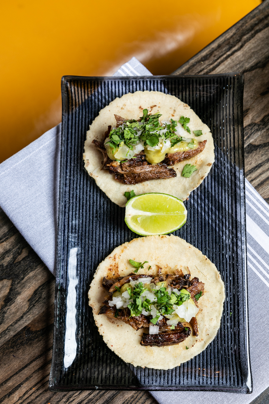 Carnita Tacos: pork confit, onion, salsa verde, and cilantro / Image: Amy Elisabeth Spasoff // Published:{ }1.5.20