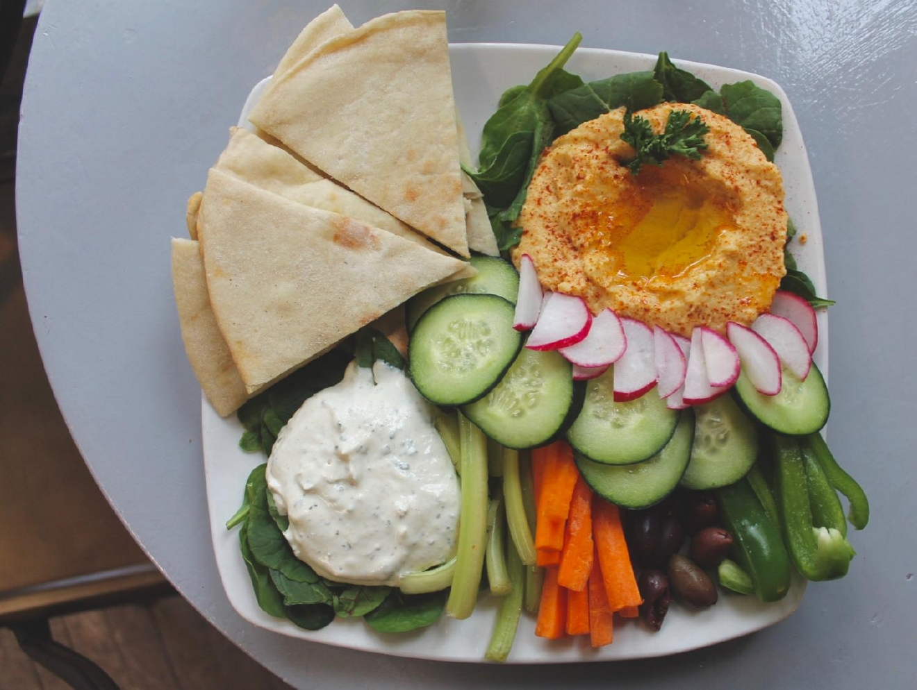 Mediterranean plate: Mama Zen's Lebanese hummus, olives, carrota, celery goat cheese pate, and house made pita / Image: Rose Brewington // Published: 3.24.17