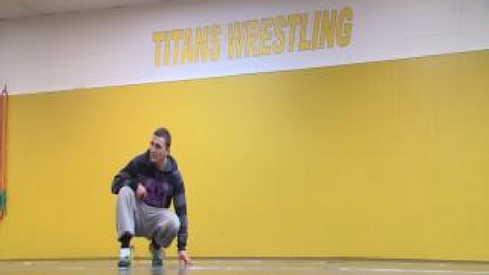 Nazar Kulchytskyy of the UW-Oshkosh wrestling team takes a breather during a recent practice session.