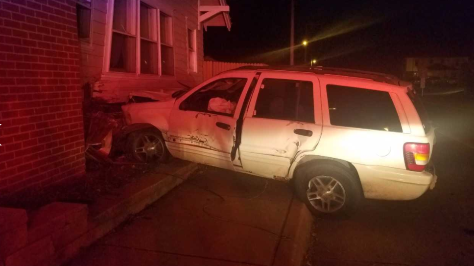 Police say a driver in a white SUV plowed into the woman's home near Admiral and Delaware. The woman living in the home says she heard a boom as the car plowed into the home. (KTUL)