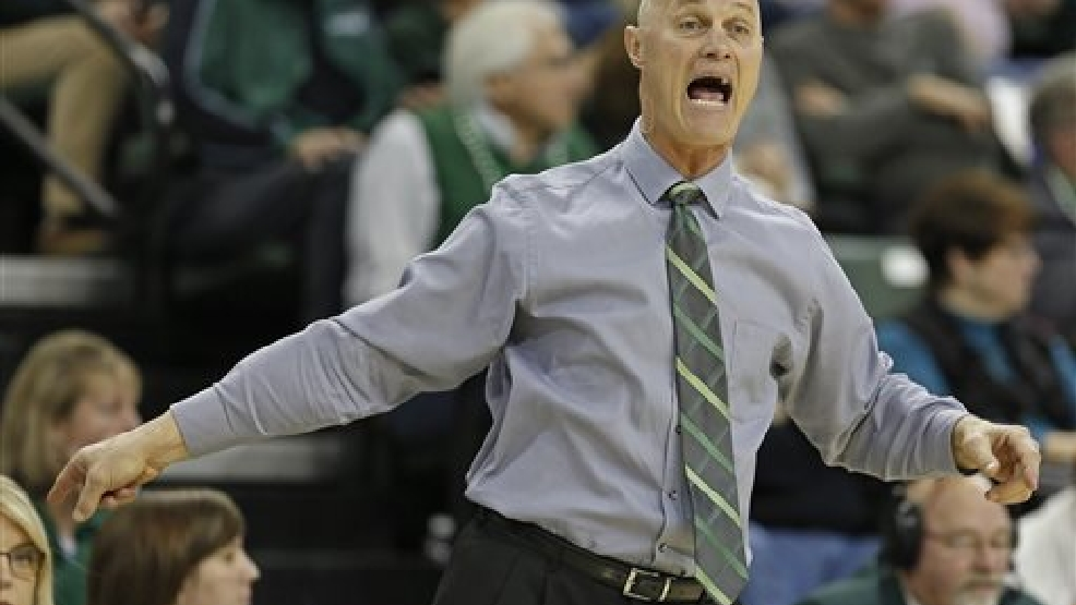 Green Bay Phoenix head coach Kevin Borseth calls out to his players during the first half of an NCAA college basketball game against Wright State for the Horizon League tournament championship on Sunday March 16, 2014, in Green Bay, Wis. (AP Photo/Matt Ludtke)