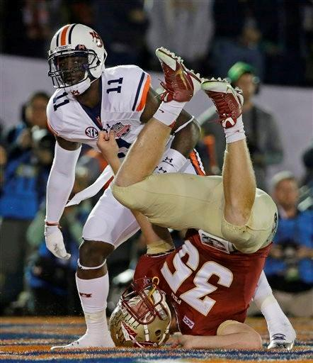Florida State's Nick O'Leary lands on his head in front of Auburn's Chris Davis (11) after leaping for an incomplete pass during the first half of the NCAA BCS National Championship college football game Monday, Jan. 6, 2014, in Pasadena, Calif.