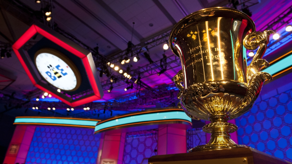 FILE - The Scripps National Spelling Bee trophy sits in wait for a winner at the start of the second round of competition in Oxon Hill, Md., Wednesday, May 29, 2013. (AP Photo/Cliff Owen, File)