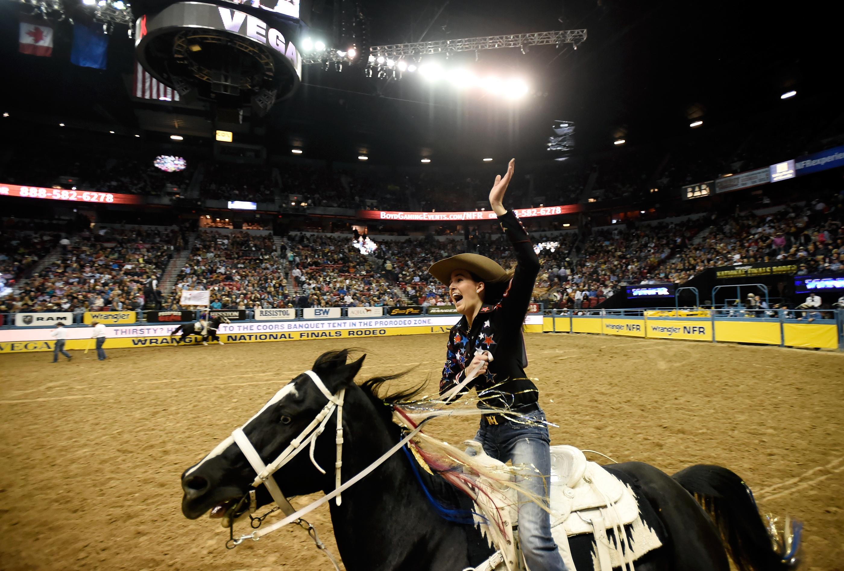 Tillar Murray from Fort Worth, Texas, acknowledges the crowd after competing in barrel racing during the seventh go-round of the National Finals Rodeo Wednesday, Dec. 13, 2017, in Las Vegas. CREDIT: David Becker/Las Vegas News Bureau
