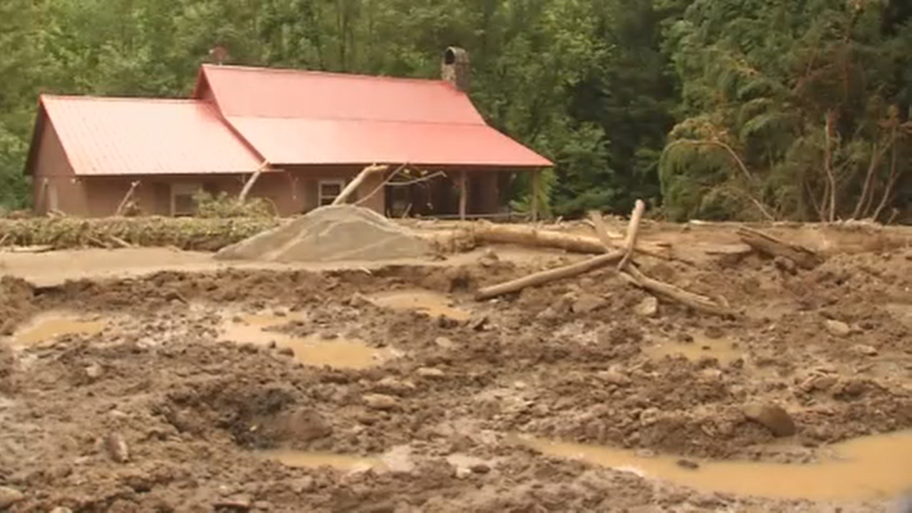 <p>For the first time, News 13 was allowed around the barricades and into the area where a Polk County woman was killed when a mudslide surrounded her home and trapped her inside. (Photo credit: WLOS staff)</p>