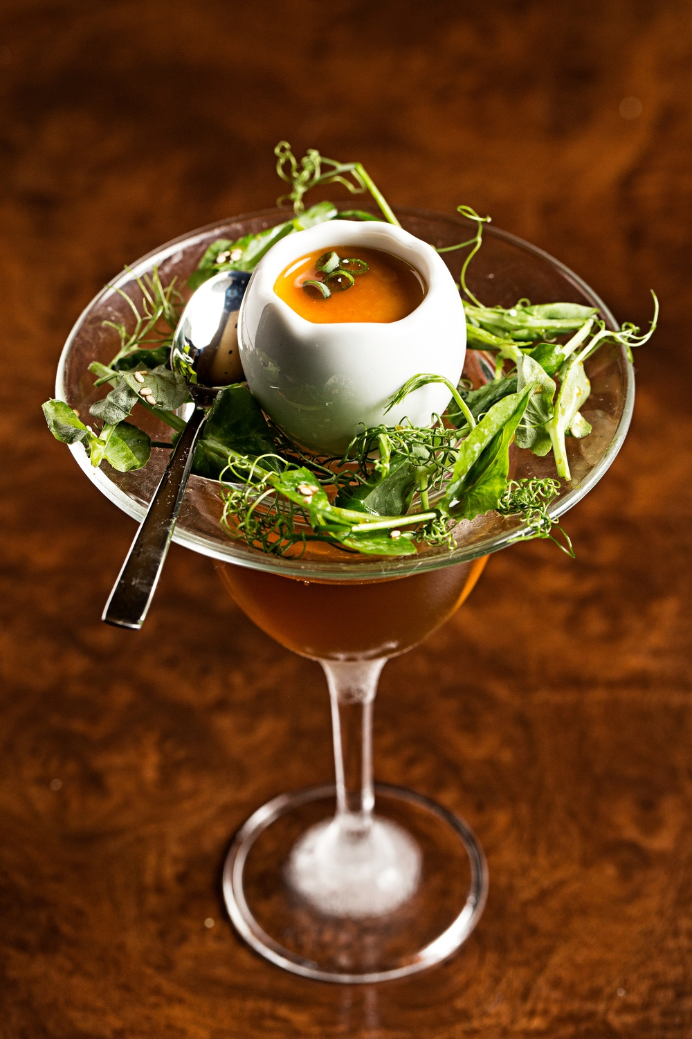 "Sample drinks such as the ""Temple Walls"" (Japanese whisky, medium sherry and Cointreau infused with saffron, thyme and chocolate accompanied by egg custard, dashi broth, English peas with a pea tendril and sesame seed salad) on both the three or five-course tasting menus. (Image: Scott Suchman)"