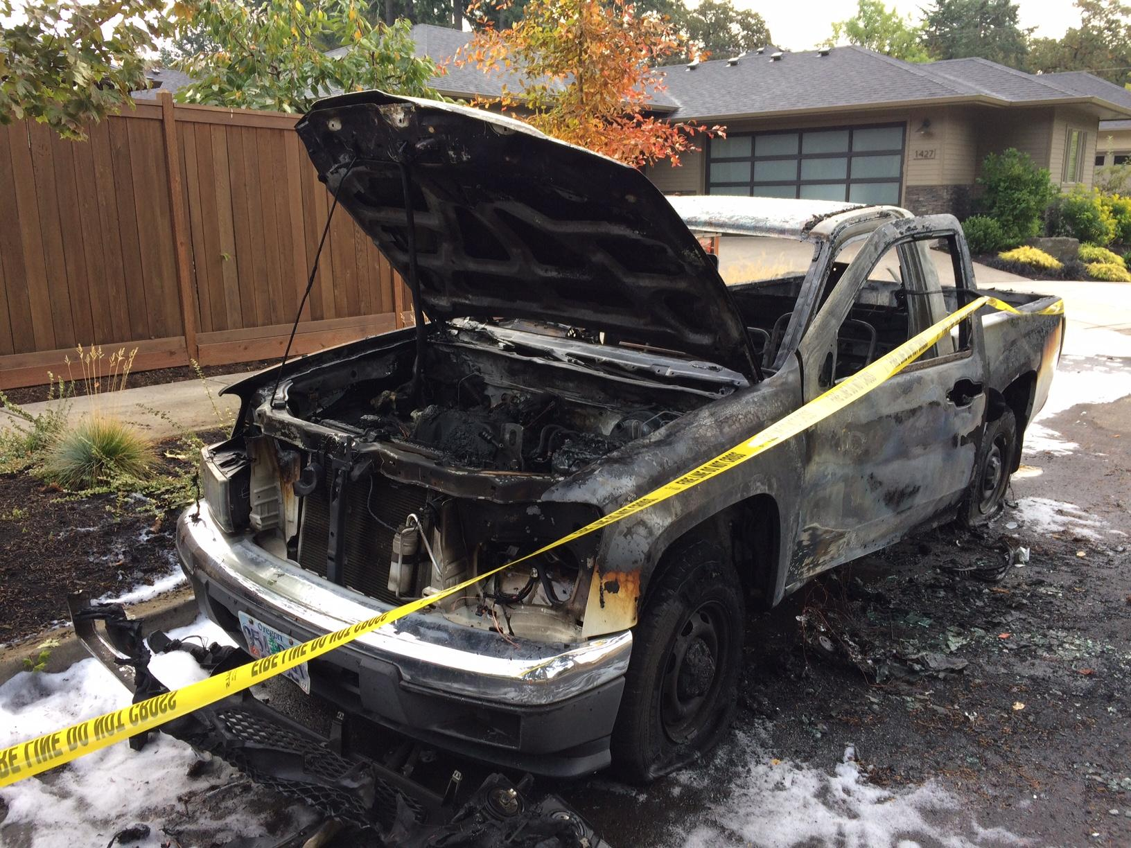 Eugene Police & Eugene-Springfield firefighters were called to the 1400 block of Hammock Street where it was reported two cars were on fire, October 17, 2017. (SBG)