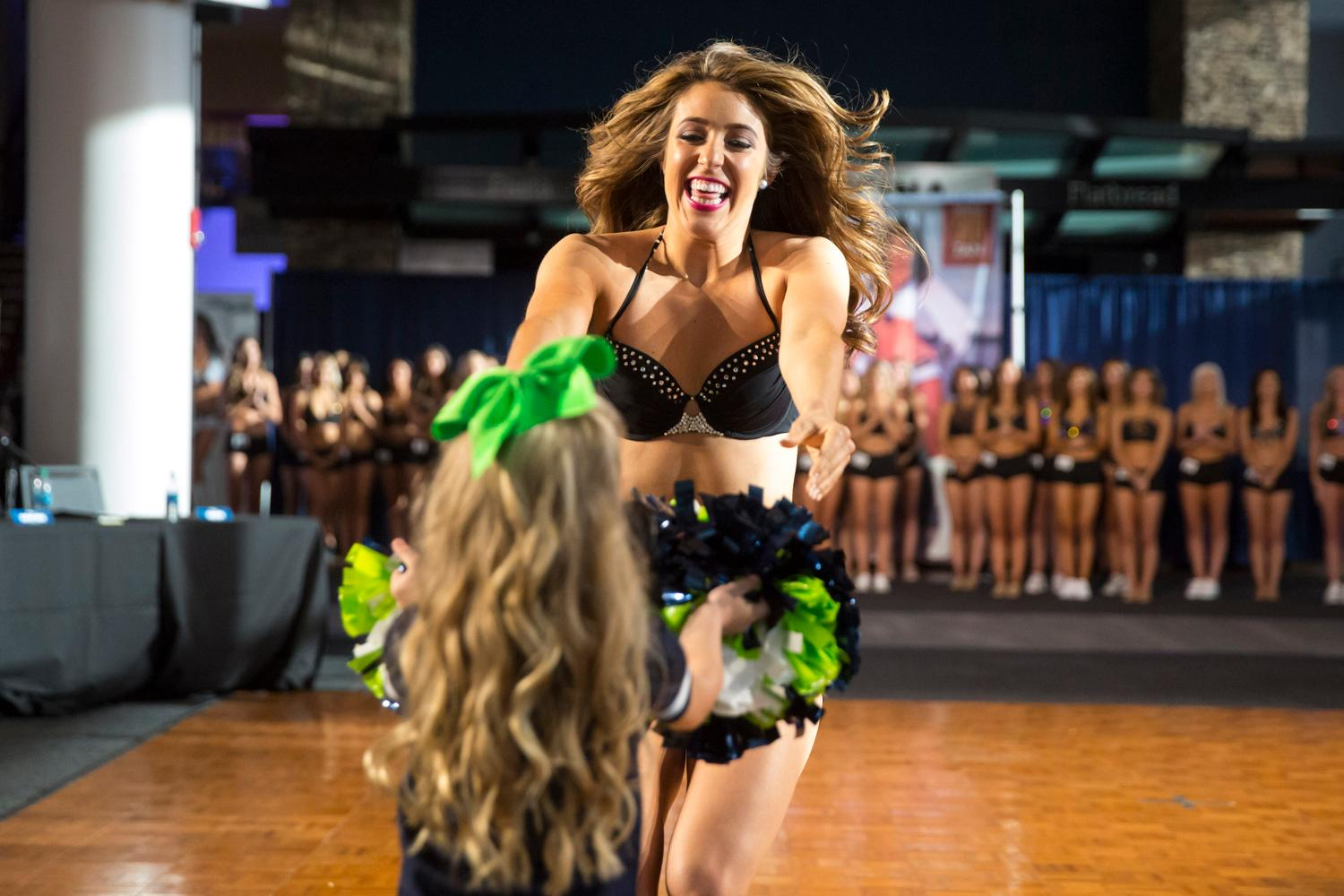 Welcome Megan, a 2018 Sea Gal! Dancers performed a choreographed routine and spoke briefly about themselves. The entire evening was live broadcasted on the Seahawks website. (Sy Bean / Seattle Refined)