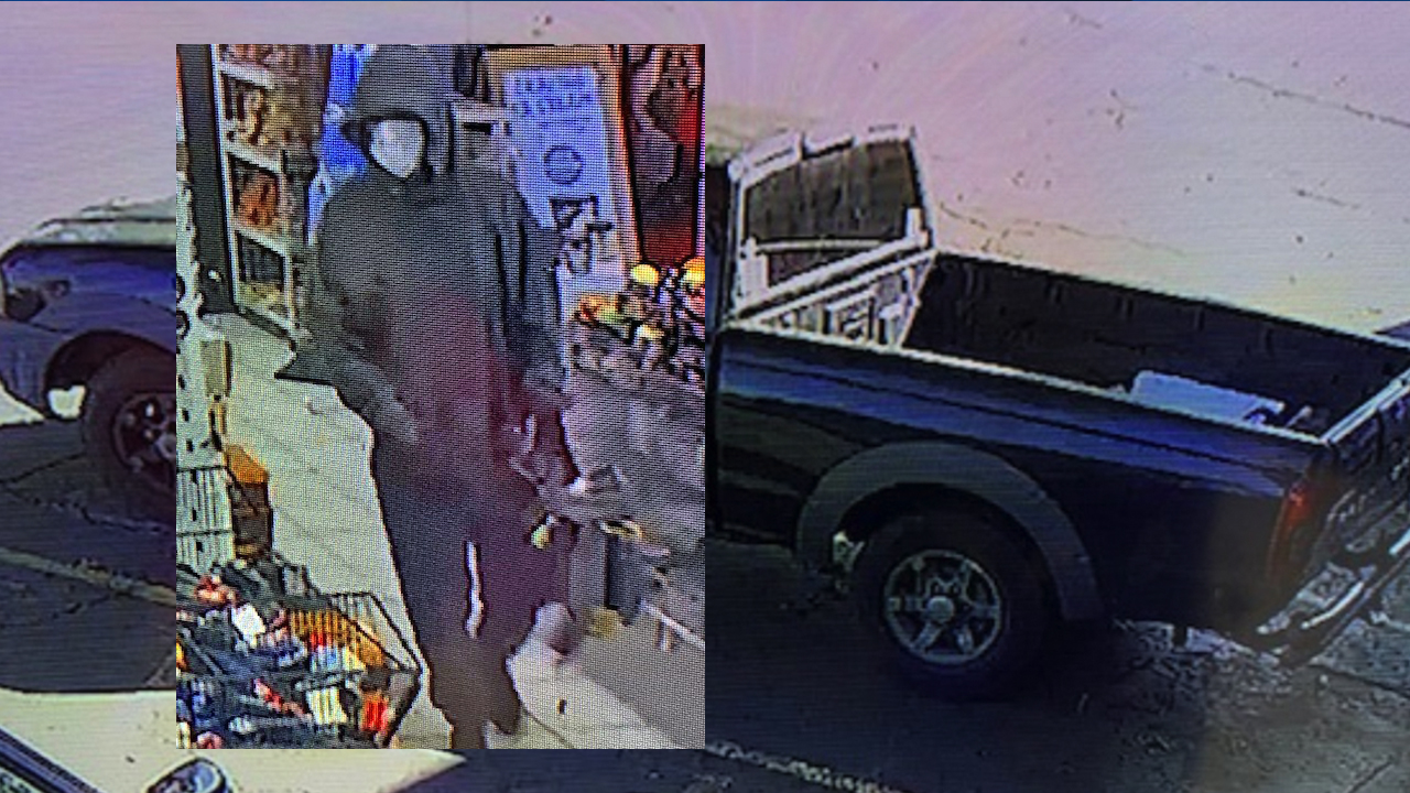 Image of the suspect in the Salem robbery on October 15 alongside the getaway vehicle - Salem Police photos.jpg