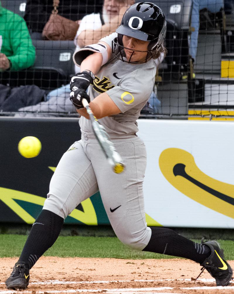 Oregon Ducks Mia Camuso (#7) swings at the ball in order to give the Ducks a chance to score. The Ducks are now 35-0 this season matching a NCAA record for most consecutive wins to start a season, winning the first game 3-1 then following up with a 8-0 win in the second and will next play UCLA on April 7th in Los Angeles, California. Photo by Jonathan Booker, Oregon News Lab
