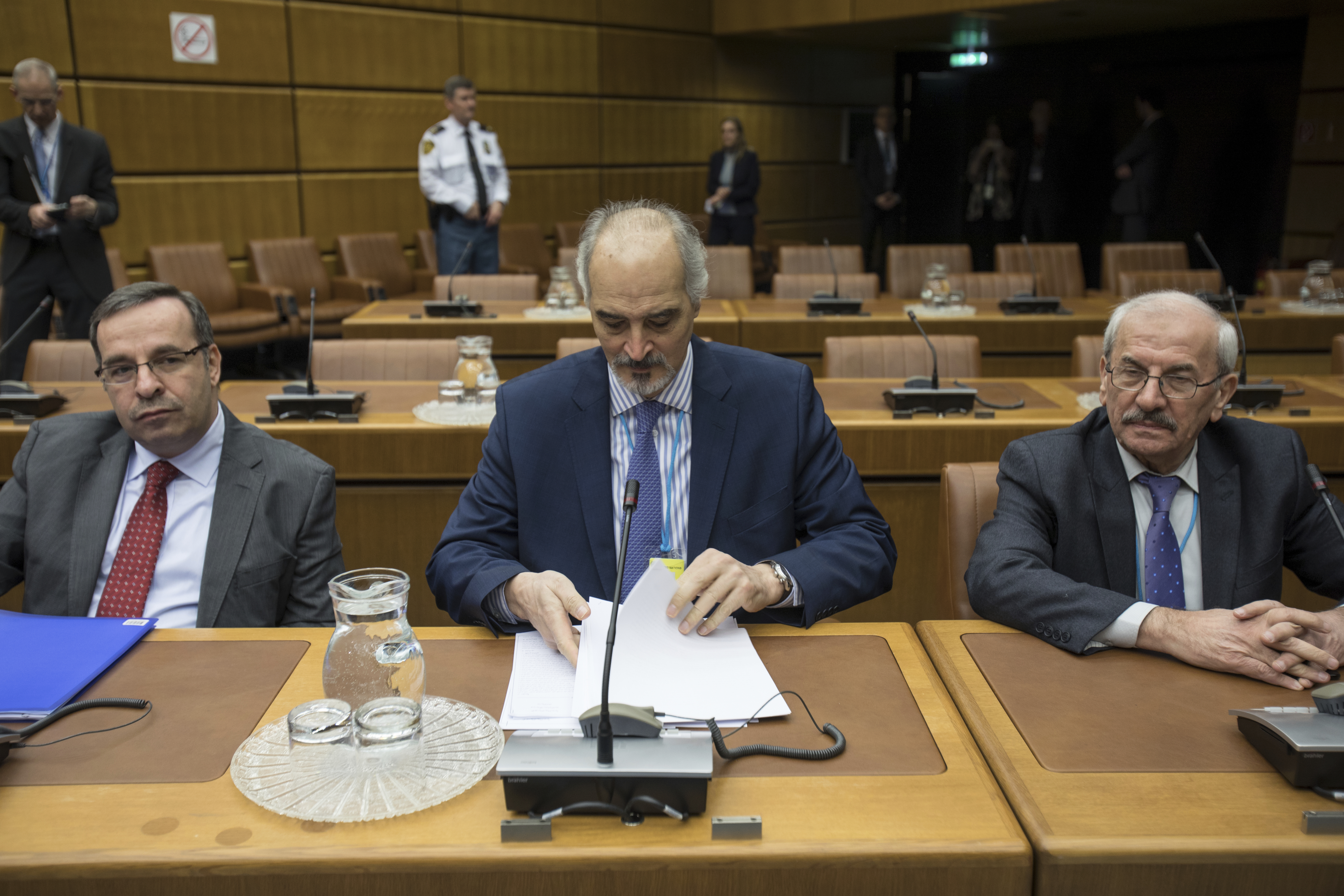 Syrian chief negotiator and Ambassador of the Permanent Representative Mission of Syria to the United Nations, Bashar al-Jaafari, centre, sits sits with members of Syrian delegation before the start of official talks on Syria, in Vienna, Austria, Thursday Jan. 25, 2018.  (Alex Halada/pool via AP)