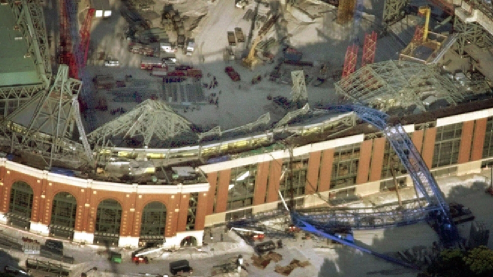 A giant crane, lower right, used in the construction of the Milwaukee Brewers' new stadium Miller Park, collapsed on July 14, 1999, in Milwaukee. (AP Photo/Morry Gash)