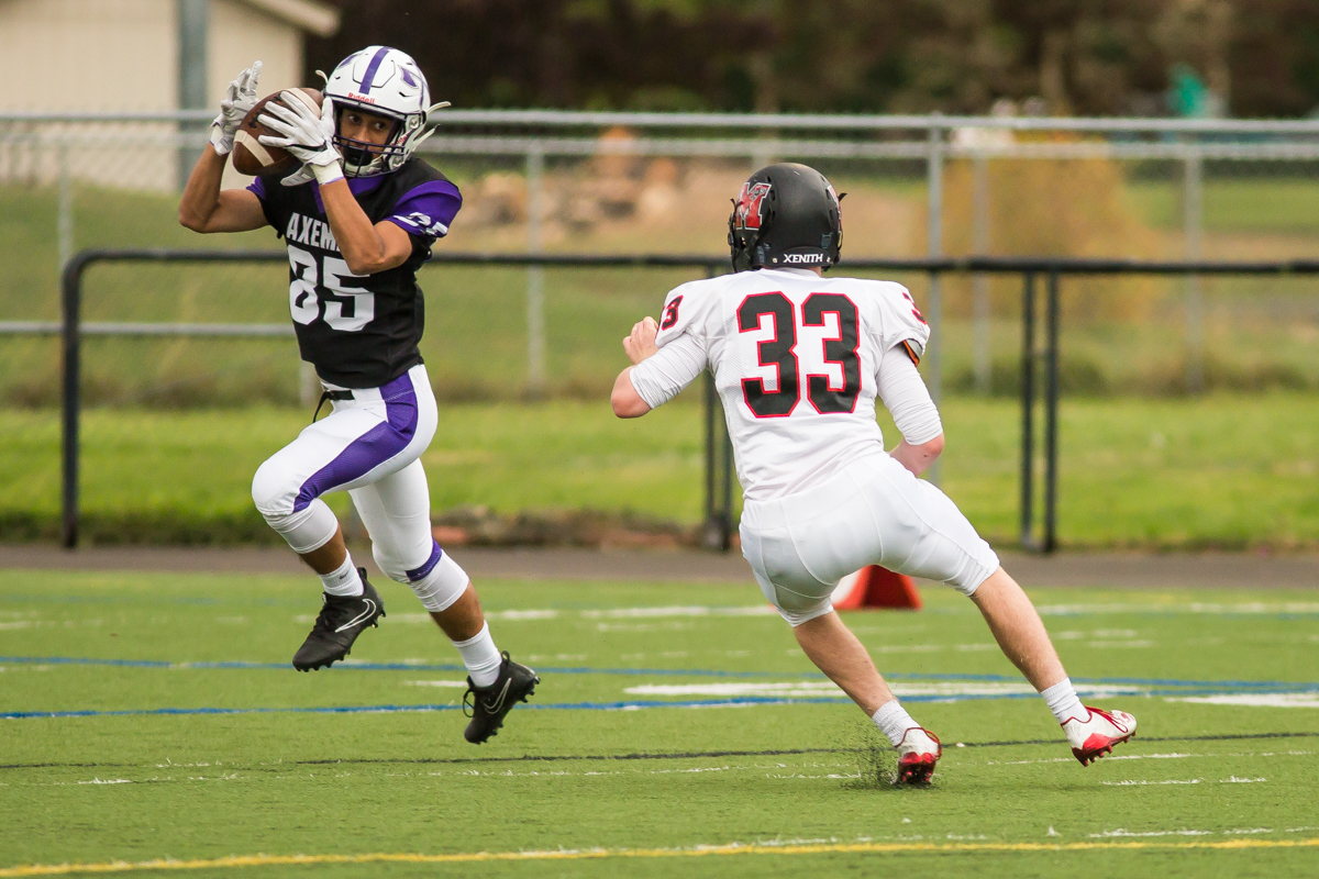 South Eugene receiver Malcom Yates (#85) catches a pass amid coverage from North Medford  linebacker Dallin England(#33). The game had been postponed from Friday due to unhealthy levels of smoke in the atmosphere due to nearby forest fires. Photo by Dillon Vibes