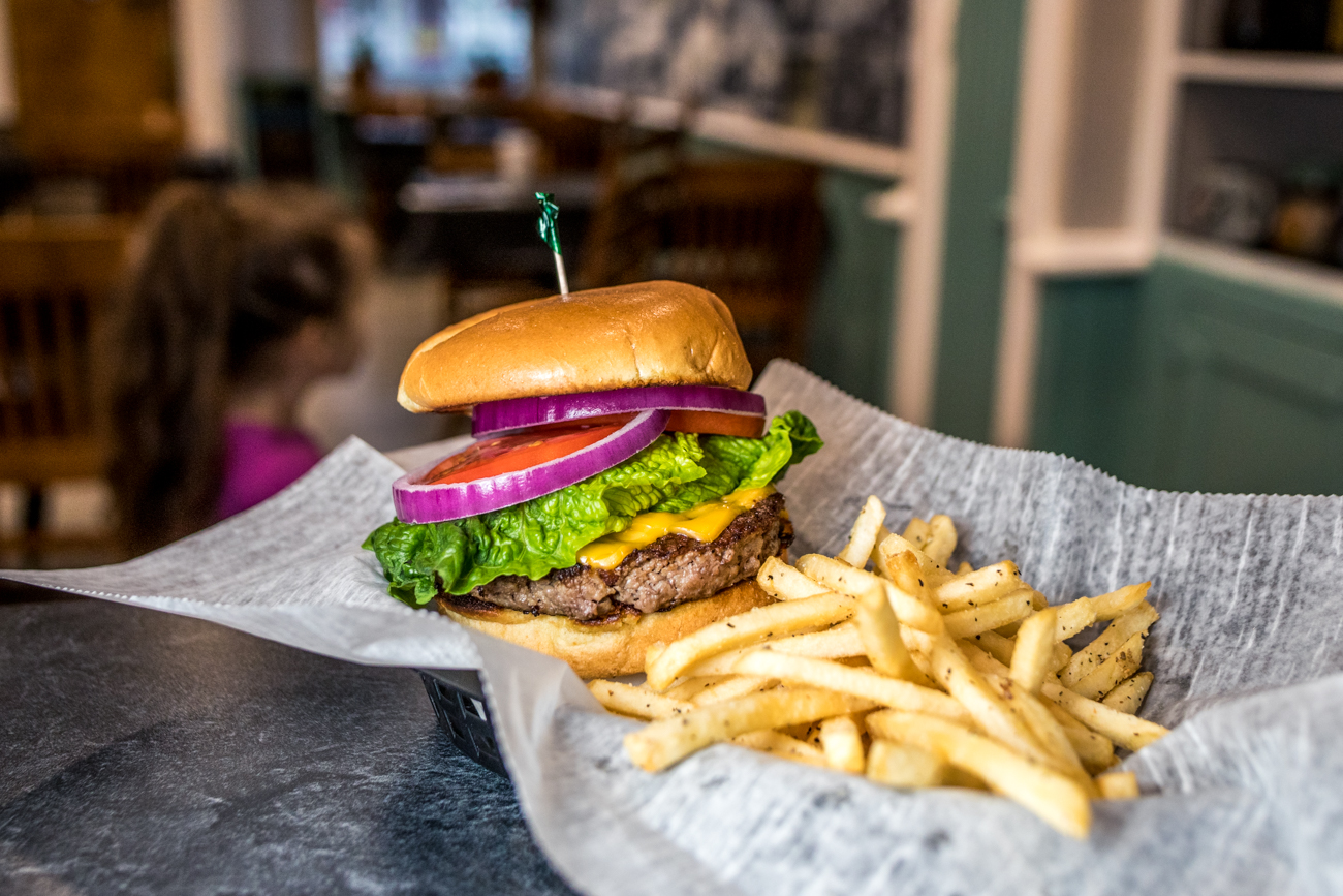 Just A Burger: 1/3 lb. Angus burger, choice of cheese, lettuce, tomato, and onion served with fries / Image: Catherine Viox // Published: 2.1.21