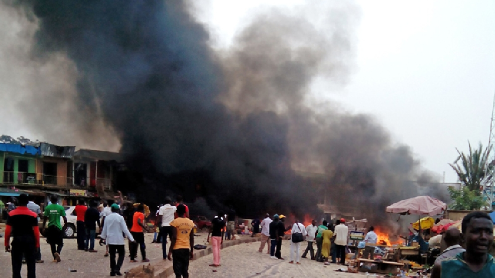 Smoke rises after a bomb blast at a bus terminal in Jos, Nigeria, Tuesday, May 20, 2014. (AP Photo/Stefanos Foundation)