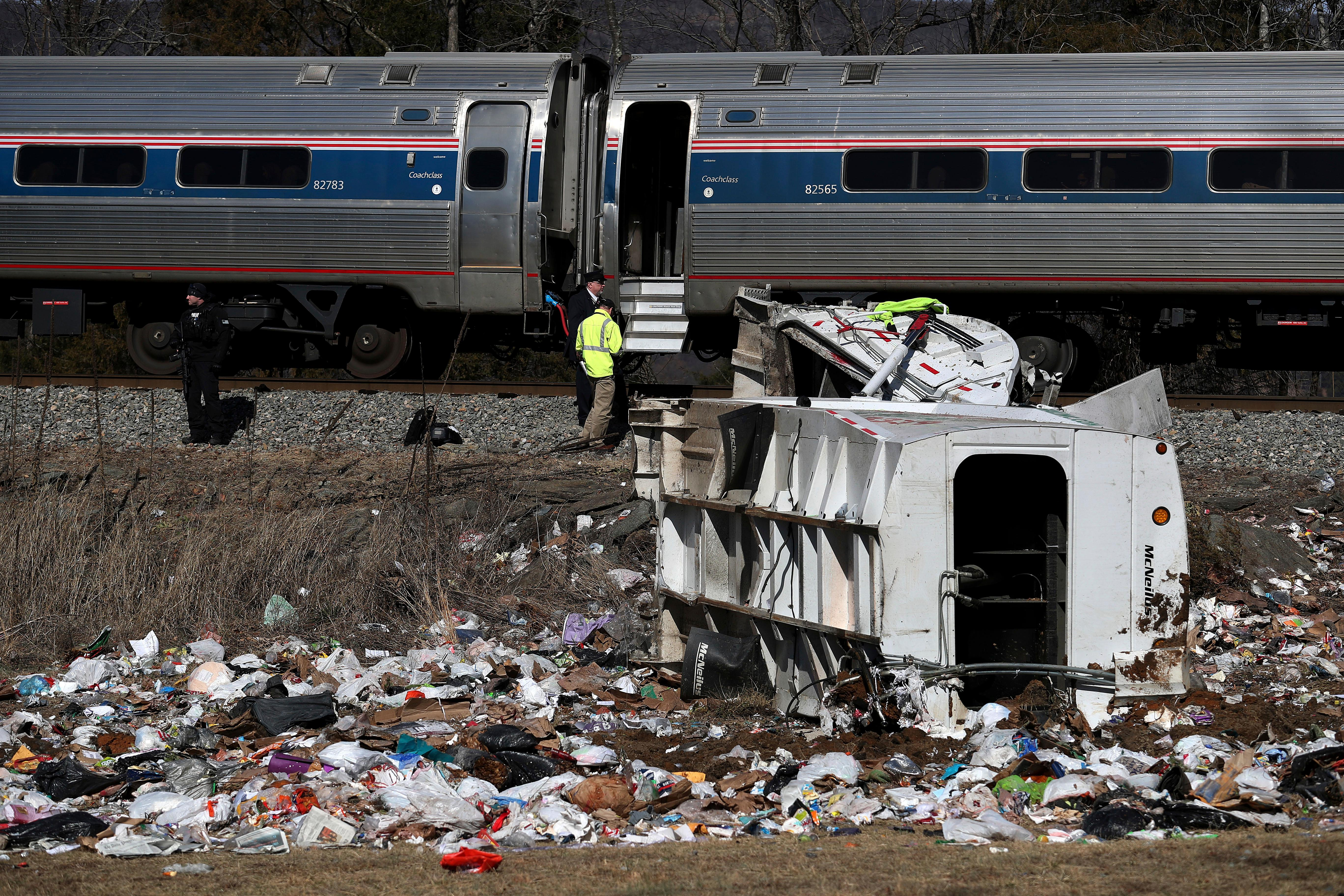 Emergency personnel work at the scene of a train crash involving a garbage truck in Crozet, Va., on Wednesday, Jan. 31, 2018. An Amtrak passenger train carrying dozens of GOP lawmakers to a Republican retreat in West Virginia struck a garbage truck south of Charlottesville, Va. (Zack Wajsgrasu/The Daily Progress via AP)