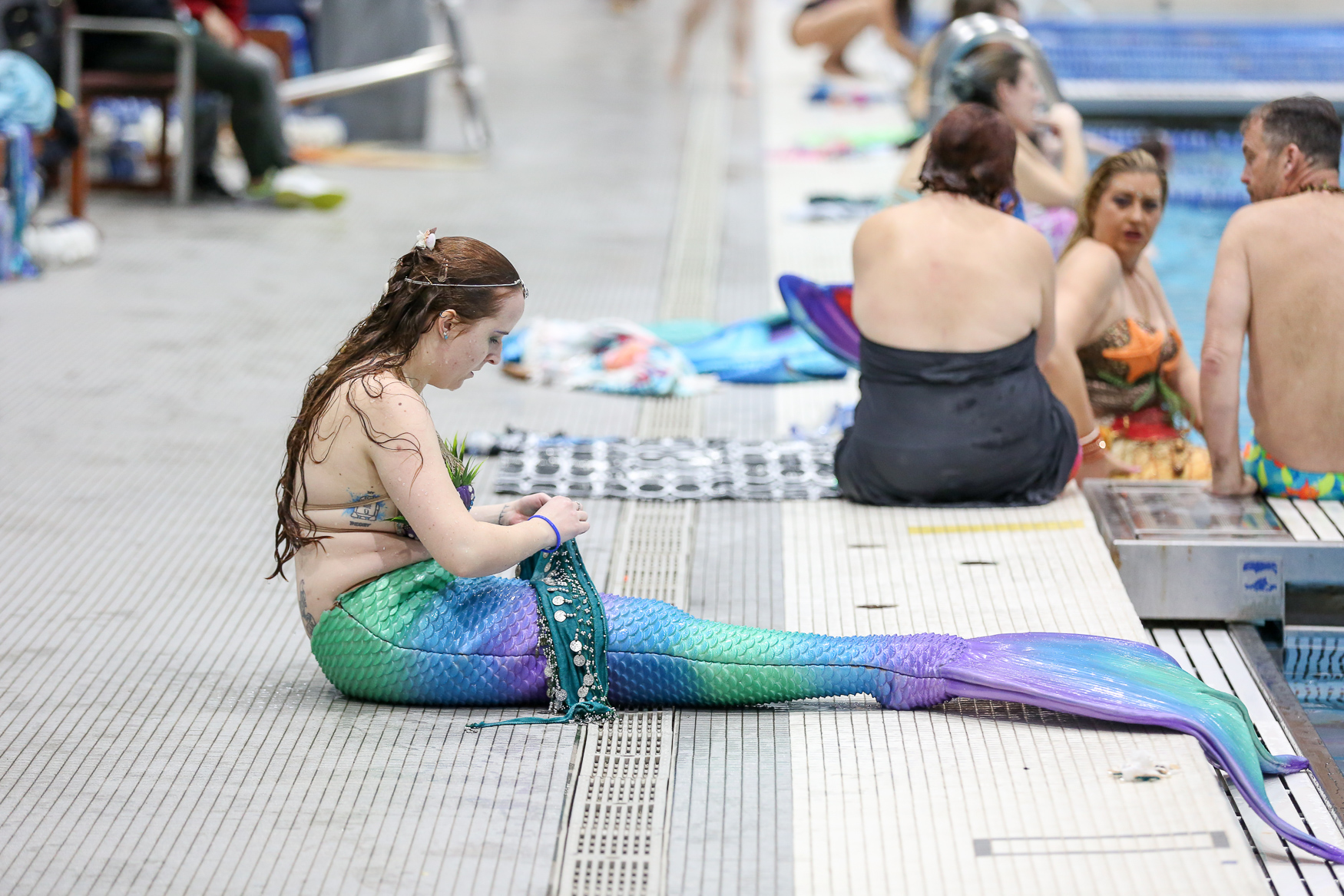 The MerMagic Con splashed into the Freedom Aquatic and Fitness Center in Manassas, Virginia this weekend. Hundreds of people of all ages from all over the world joined in on the fun, donning mermaid (and merman) fins and splashing through the water for photo shoots, classes on how to be a better mermaid and safety in the water. The convention, which runs from Friday to Sunday, February 24, also has offerings from mermaid-centric vendors. However, the whole point is to just have fun. (Amanda Andrade-Rhoades/DC Refined)