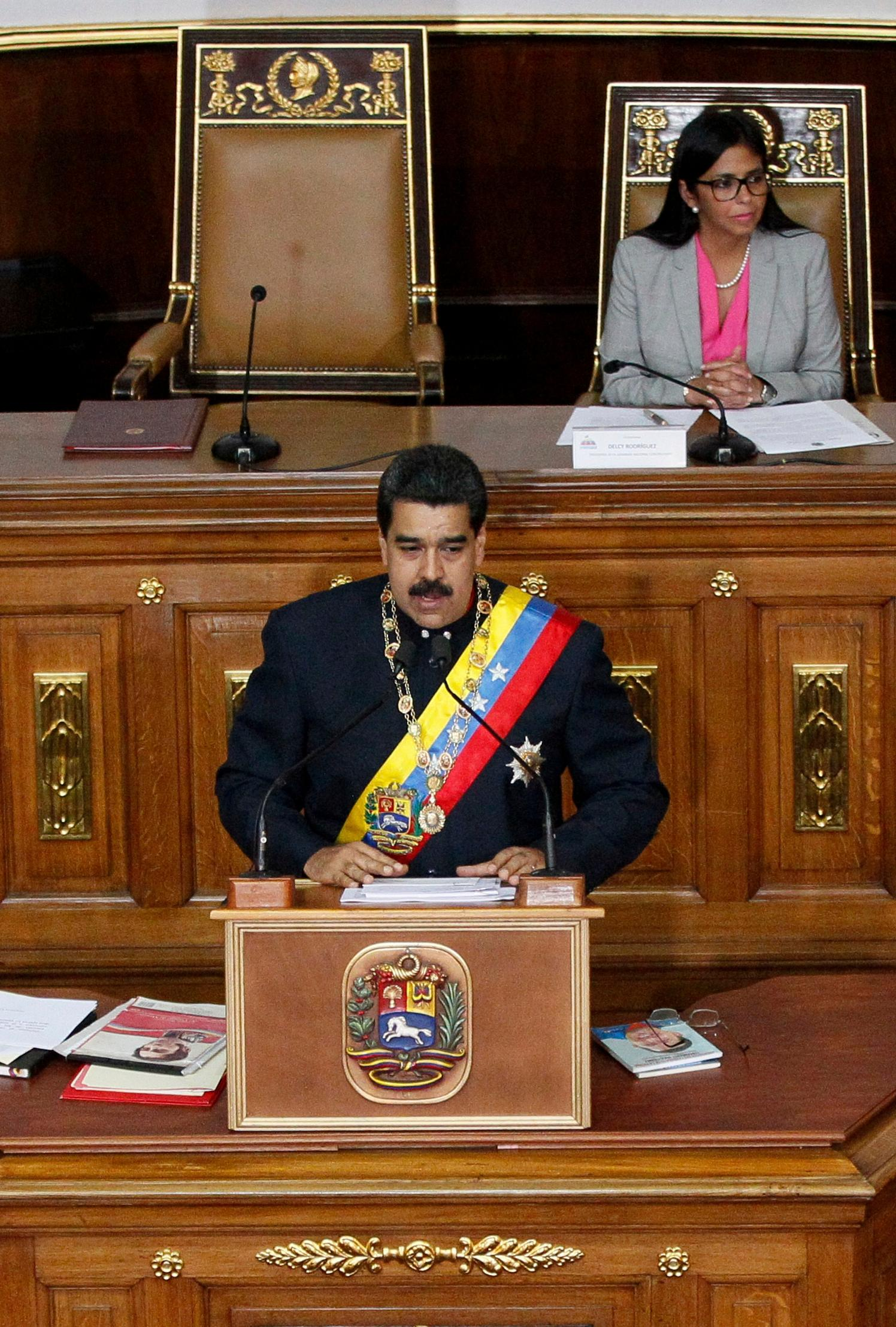 Venezuela's President Nicolas Maduro addresses Constitutional Assembly members during a special session at the National Assembly building in Caracas, Venezuela, Thursday, Aug. 10, 2017.  Behind is the president of the new constitutional assembly, Delcy Rodriguez. The new constitutional assembly has declared itself as the superior body to all other governmental institutions, including the opposition-controlled congress. (AP Photo/Ariana Cubillos)