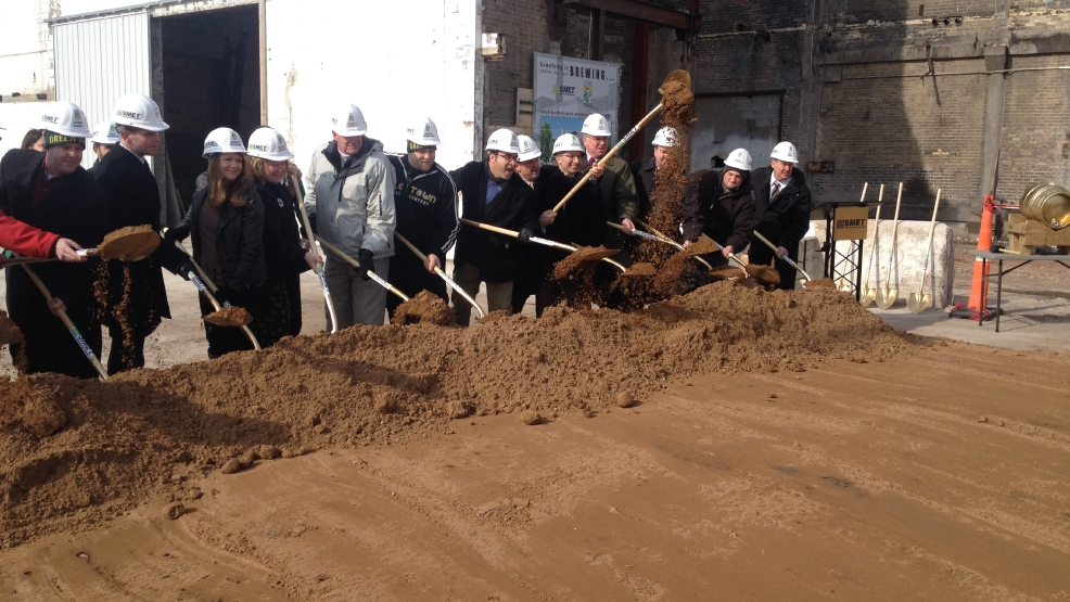 Titletown Brewing Co. leaders and city officials break ground on the brewery's downtown Green Bay expansion, March 18, 2014. (WLUK/Bill Miston)