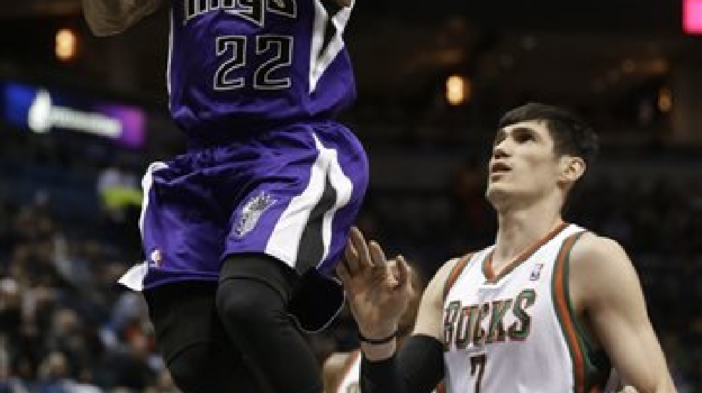 Sacramento Kings' Isaiah Thomas (22) drives past Milwaukee Bucks' Ersan Ilyasova (7) during the first half of an NBA basketball game Wednesday, March 5, 2014, in Milwaukee. (AP Photo/Jeffrey Phelps)