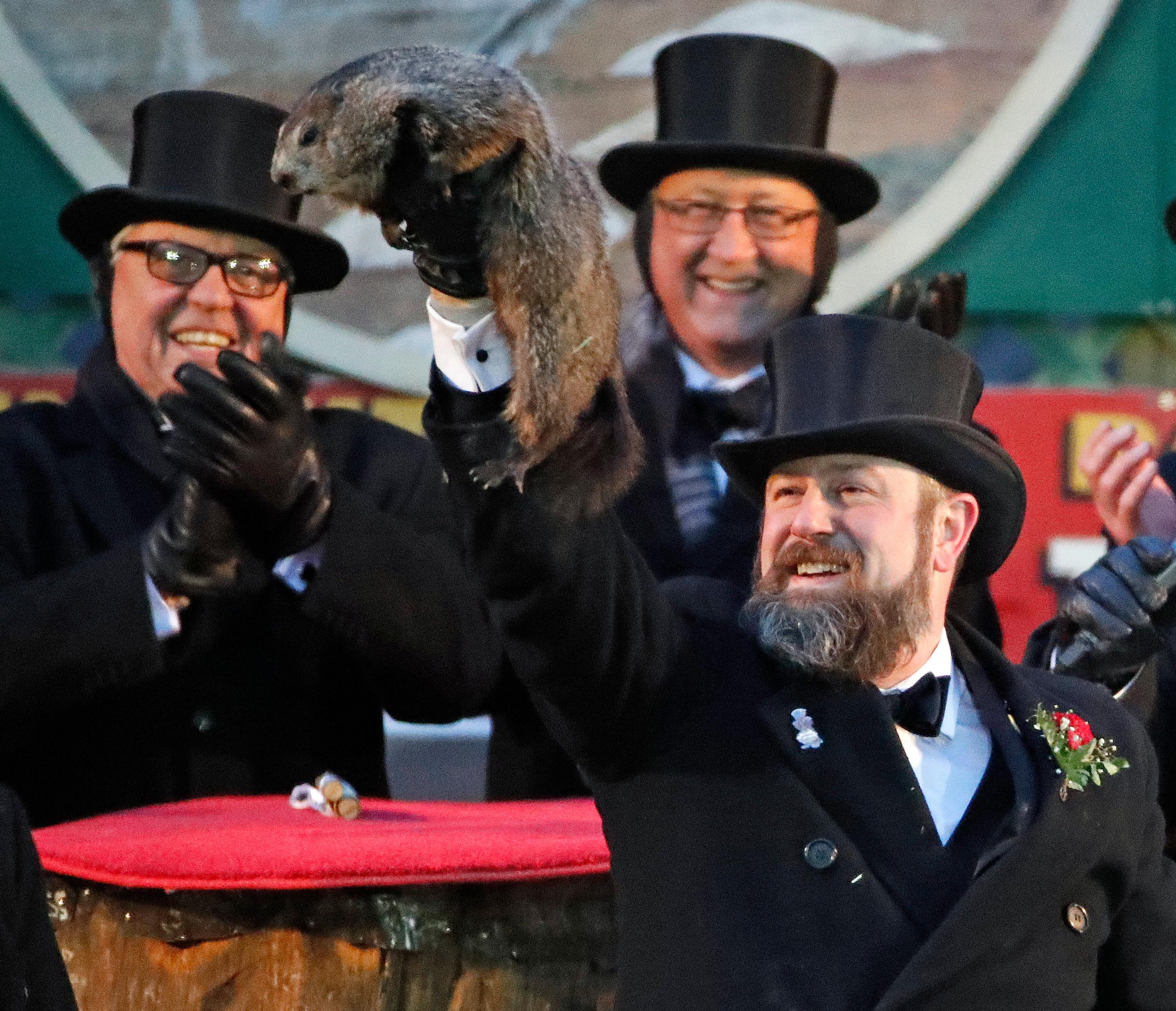 Groundhog Club co-handler Al Dereume holds Punxsutawney Phil, the weather prognosticating groundhog, during the 132nd celebration of Groundhog Day on Gobbler's Knob in Punxsutawney, Pa. Friday, Feb. 2, 2018. Phil's handlers said that the groundhog has forecast six more weeks of winter weather. (AP Photo/Gene J. Puskar)