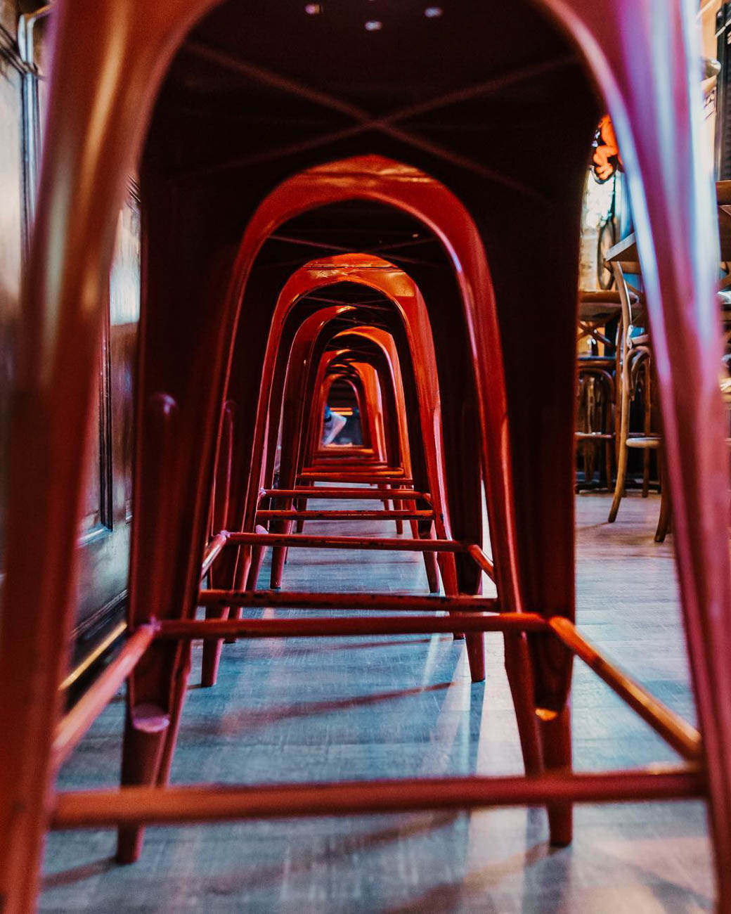 No, you're not looking through an artistically engineered tunnel. Those are the red stools from Ché Cincinnati. A different angle of perspective can make the simplest things look grandiose. / Image courtesy of Instagram user @thecincinnatist // Published: 3.20.19