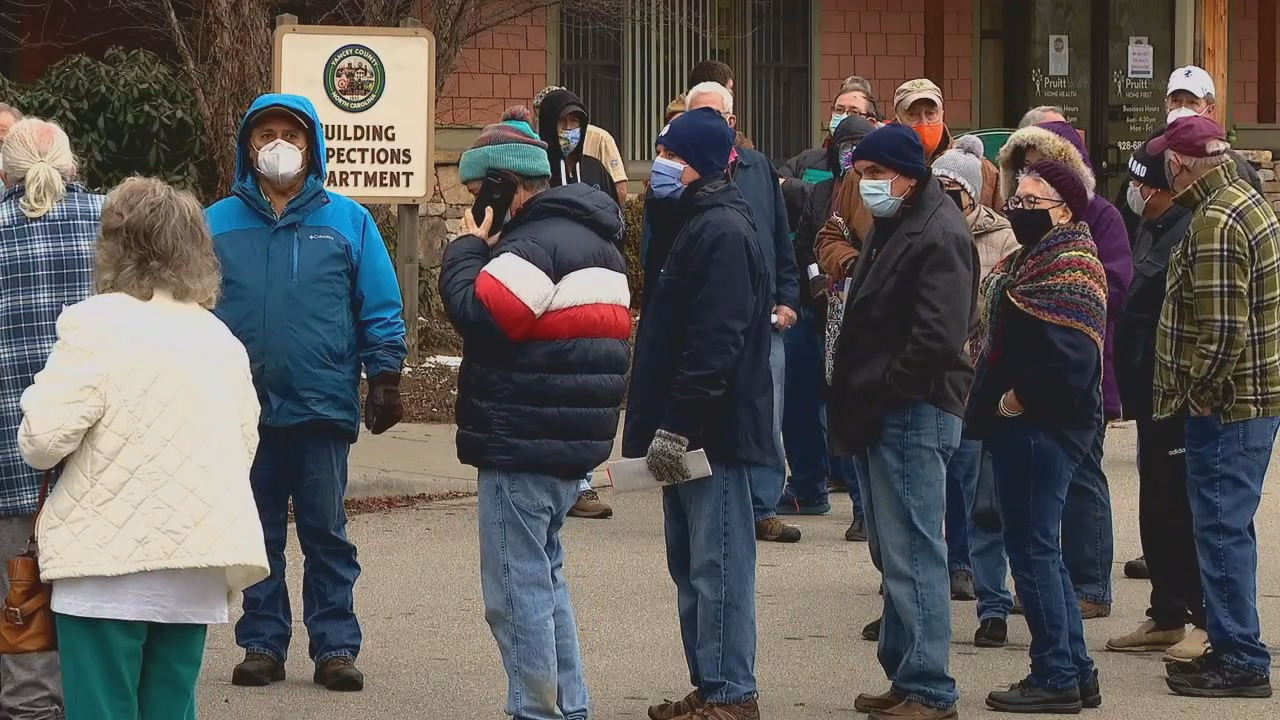 Hundreds of people waited in line in Yancey County to get the COVID-19 vaccine Tuesday. In Buncombe County, health officials are setting up a waiting list for the vaccine. (Photo credit: WLOS staff){ }