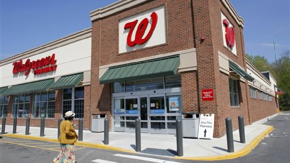 In this Wednesday, May 14, 2014 photo, a customer walks toward an entrance to a Walgreens store, in Boston.  (AP Photo/Steven Senne)