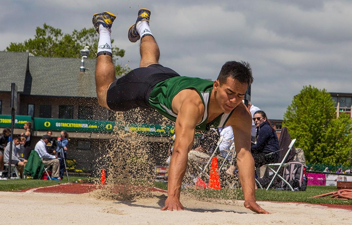 An athlete participates in the Boys Triple Jump 4A at the OSAA Track and Field State Championships at Hayward Field. Photo by Nichole Louchios, Oregon News Lab.