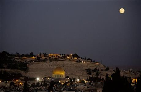 A supermoon rises over Jerusalem's Old City and the Dome of the Rock Saturday, July 12, 2014. A supermoon is an occurrence when a full moon is closest to the Earth in its orbit.