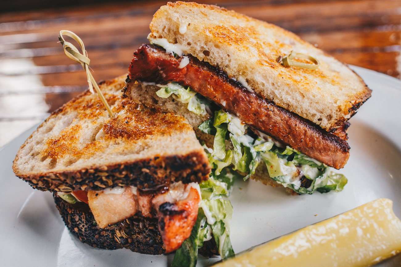 Pork Belly BLT: Cheerwine braised pork belly, lettuce, tomato, and peppercorn aioli served on Blue Oven Bad Boy bread / Image: Catherine Viox // Published: 3.24.19