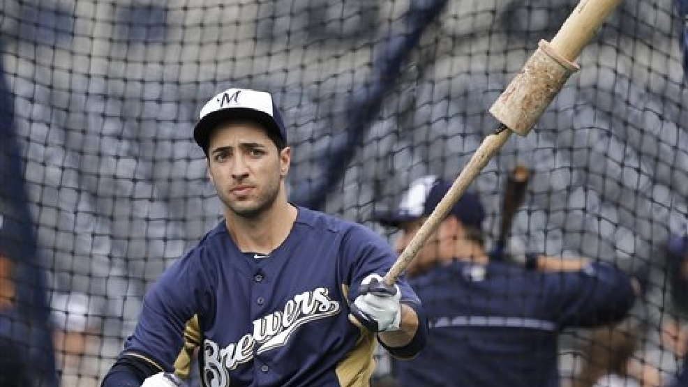 In this April 24, 2013, photo, Milwaukee Brewers' Ryan Braun swings a weighted bat outside the batting cage before the Brewers' baseball game against the San Diego Padres in San Diego. Braun has returned from suspension to a new position with the Brewers. It was the first day back for the 2011 NL MVP since being suspended for 65 games in 2013 for violating Major League Baseball's anti-drug agreement.  (AP photo/Lenny Ignelzi)