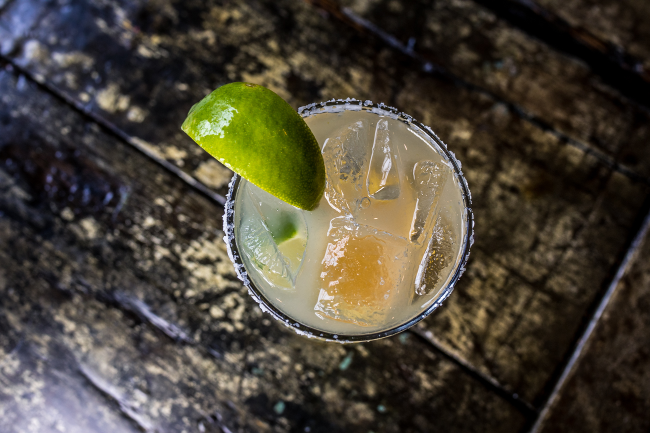Coin Style Margarita: tequila, triple sec, lime juice, and a splash of orange juice served over ice / Image: Catherine Viox // Published: 7.16.20