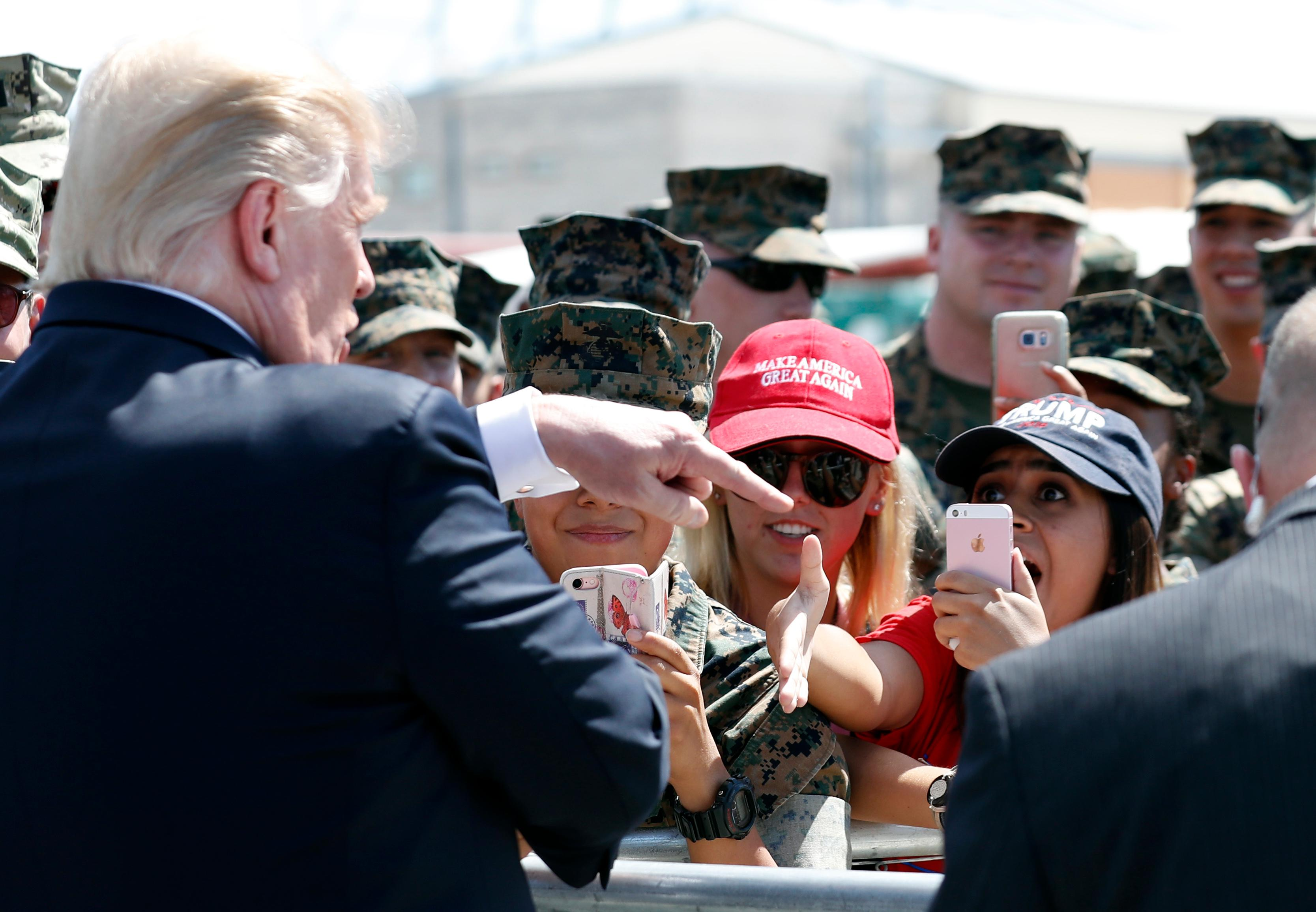 President Donald Trump greets U.S. Marines and their families before he departs Tuesday, Aug. 22, 2017, in Yuma, Ariz. (AP Photo/Alex Brandon)